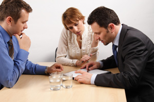 People Discussing a Postnuptial Agreement