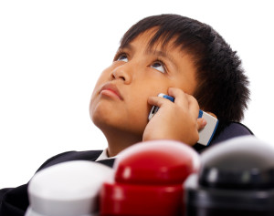 Boy With Many Telephones Pretending He Is The Boss Of A Company