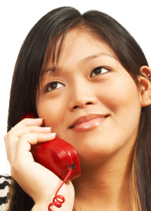 Smiling Woman Talking To Her Friend On The Phone
