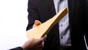 person handing over a file
