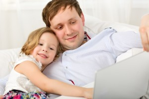 father and daughter and computer